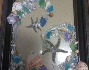 Seaglass and starfish sculpture on glass framed