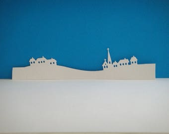 Cutting white canson paper village houses landscape