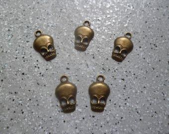 5 charm skulls, metal bronze