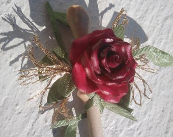 A stick decorated with a pink - to your lapel...