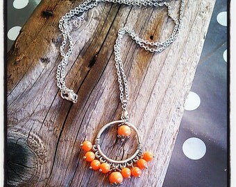 silver necklace silver ring and orange beads