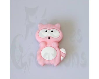 Light pink raccoon silicone pacifier, rattle etc.