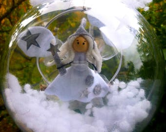 White Angel/fairy in the middle of the clouds and stars / in a transparent ball