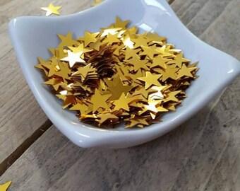 Glitter / confetti stars gold 10 mm in diameter