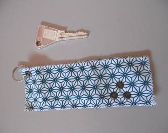 Eyelet and fabric key fob with geometric patterns