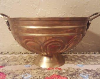 Small vintage brass round pedestal planter.  Ornate brass pedestal bowl.  Vintage pedestal bowl with grape detailed handles