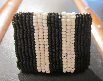 embroidered ring with unique, striped beads black and white