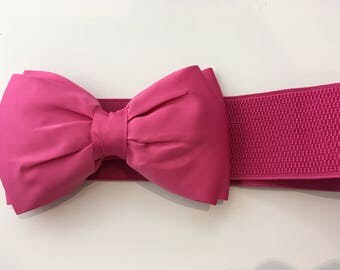 Pink elastic belt with a bow