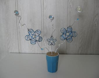 composition of flowers made of aluminium and beads