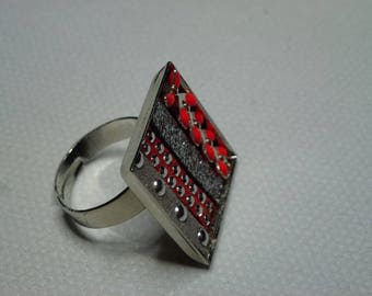 Gray and coral ring