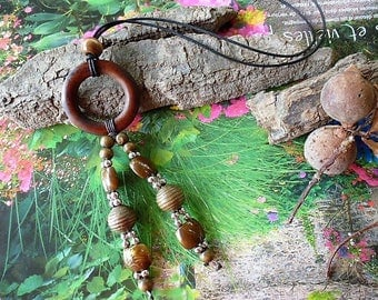 cool style with ring pendant necklace and wooden beads on waxed cotton cord