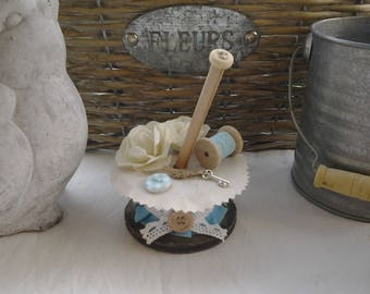 Large wooden spool decorated