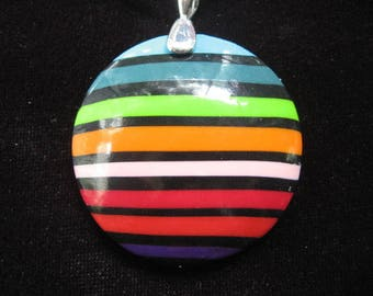 Pendant with multicolored stripes on black background