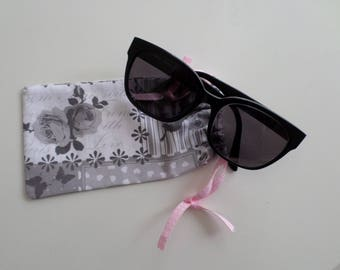 glasses case made in a gray and white patchwork fabric