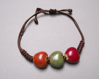 Bracelet waxed cord and ceramic beads.