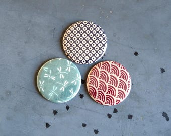 Trio of Japanese fabric covered Pocket mirrors