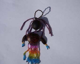 character in tropical seeds and seed beads