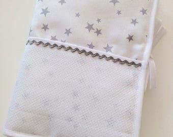 Health book has cross-stitch, silver stars.