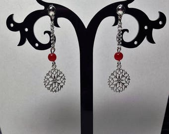 Earrings are print and Red jade beads