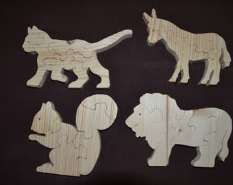 Puzzles of five to eight pieces tree animals