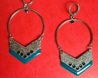 round silver backed geometrix earrings