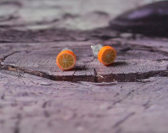 Orange stud earrings. jewel