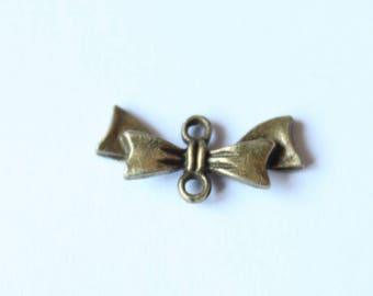Insert bow bronze plated 20 mm, set of 5