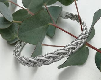 White leather cord and silver pewter Sami bracelet.
