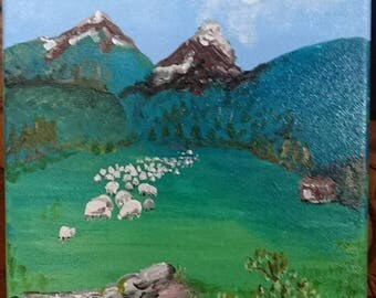 Flock of sheep and mountain pasture