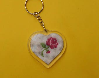 Heart shaped key chain with a rose