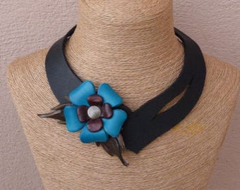 Lacy asymmetric black leather necklace in staggered turquoise flowers