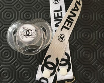 the white chanel girl brand pacifier