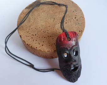 Small red and black polished ceramic pendant mask