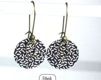 Earrings features small print