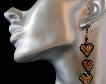 my creation is handmade earrings woven nine heart