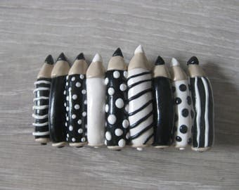 Hair clip with black and white colored pencil (Fimo)