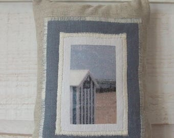 Image of a beach cabin door cushion