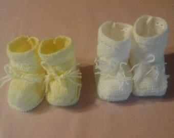 Yellow or white baby booties