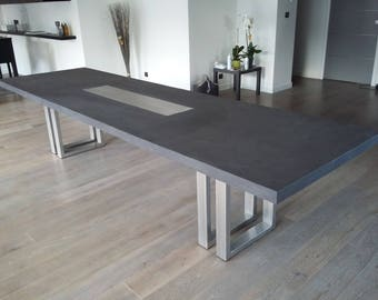 Waxed gray concrete with brushed stainless steel double feet table