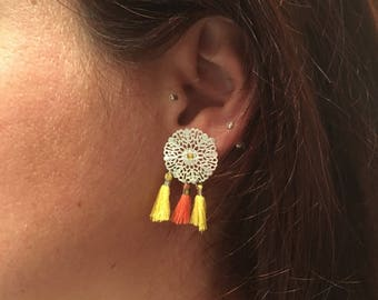 Earrings yellow PomPoms and orange and silver dn print