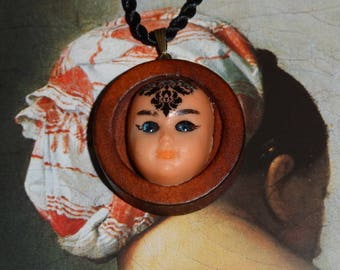 The oracle fickle (pendant on cord)