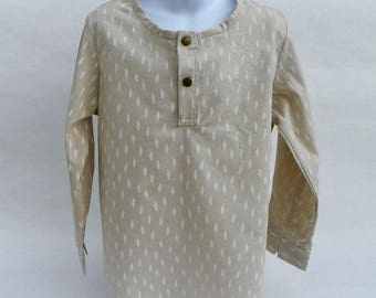 Blouse beige cotton girl patterned feathers.