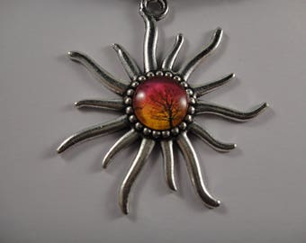 Pretty necklace with Pendant in the shape of Sun and the Center a glass cabochon