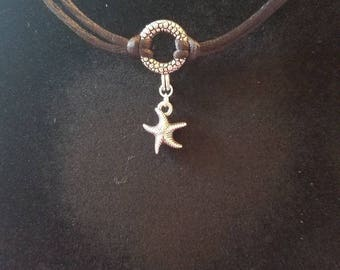 Silky cord with a starfish charm on a antique silver bubbled toggle