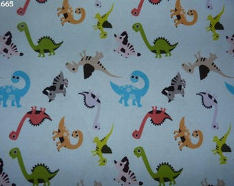 Fabric C665 dinosaurs on blue coupon 50x50cm