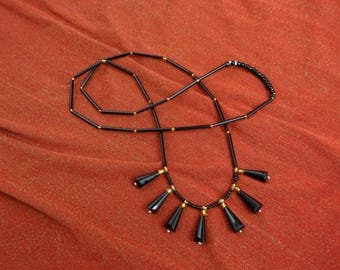 Long black tube seed beads long black