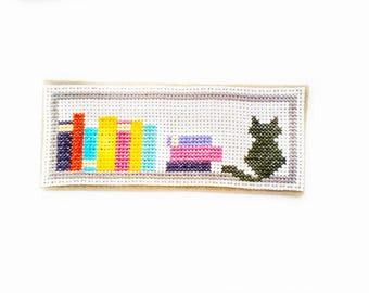 Embroidered bookmark reading