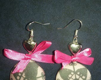 pink button and bow earring