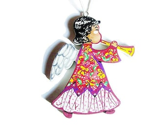 Christmas/Christmas Decor. little angel dressed in red with trumpet tree