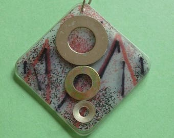 Square pendant in resin, paper, ink drawing and bolts